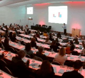 Dr Nigel Plummer giving a keynote speech to fellow professionals