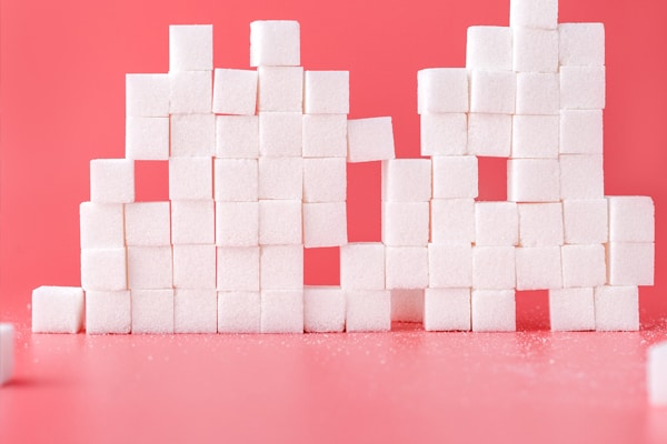 How can sugar impact gut bacteria?
